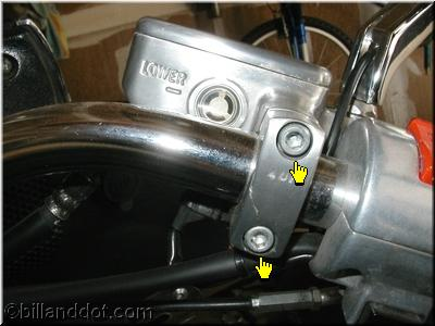 Reservoir Handlebar Clamp (Pointers Indicate Bolts)